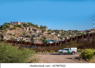 Editorial June 10, 2017 - Border patrol car on the US side of the international border between United States and Mexico