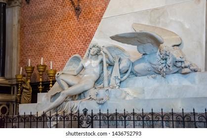 Editorial. June, 2019. Venice, Italy. Fragment of the monument dedicated to Canova in the interior of the Basilica di Santa Maria Gloriosa dei Frari. The figure of the genius of Canova