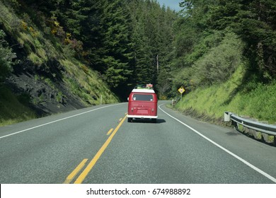 Editorial May 17, 2017: Lifestyle photo of a red VW van driving along scenic Oregon Coast