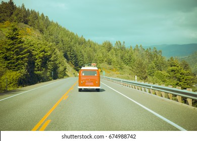 Editorial May 17, 2017: Vintage Lifestyle photo of a red VW van driving along scenic Oregon Coast
