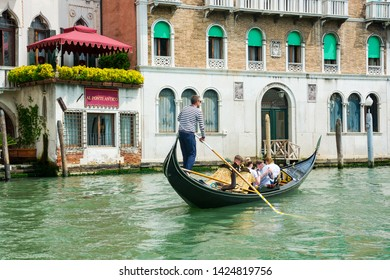Editorial. May 2019. Venice, Italy. View of the city Grand Canal in Venice in a sunny day. Gondolier driving the gondola with tourists