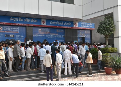 EDITORIAL: NOV 12th, 2016: Gurgaon, Delhi, India: Long queue of people outside banks to deposit old 500 and 1000 currency notes and get new currency. Demonetization of Rs 500 and Rs 1,000 currency