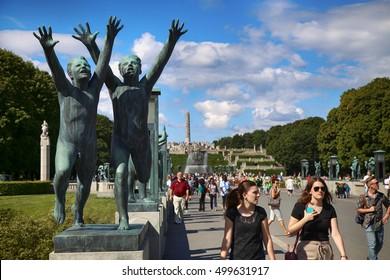 EDITORIAL OSLO, NORWAY - AUGUST 18, 2016: Many tourist walk Vigeland Sculptures Park in the popular Vigeland park ( Frogner Park ), designed by Gustav Vigeland in Oslo, Norway on August 18, 2016.