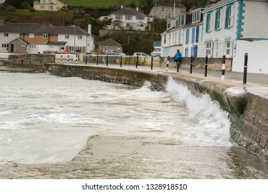 Editorial: People & Logos. Portmellon, Mevagissey, Cornwall, UK. 03/03/2019. Large swells kicked up by storm Freya crash against the sea defence at Portmellon.
