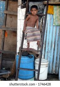 editorial: a poor boy in a slum in mumbai india