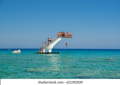 EDITORIAL: RHODES ISLAND , 30 JULY 2012 , GREECE PEOPLE DIVING TO THE SEA, people  diving in the sea summer vacations in greece
