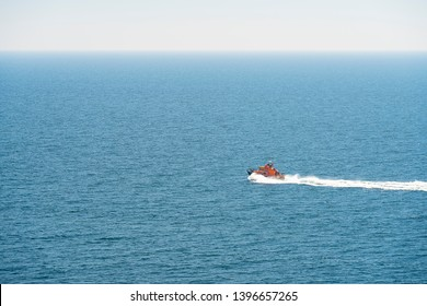 Editorial: RNLI, Polkerris, Cornwall, UK, 11/05/2019. The RNLI lifeboat races across the sea in the St Austell Bay heading back to it's mooring point in Fowey.