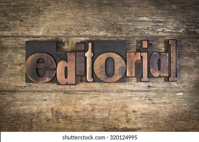 editorial, set with vintage letterpress printing blocks on wooden background - Shutterstock ID 320124995