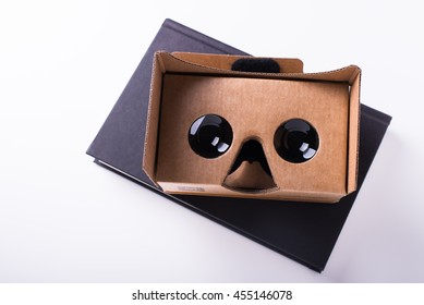 editorial shot for Google cardboard virtual reality headset, isolated over a white background on a black book. Taken on July, 2016.