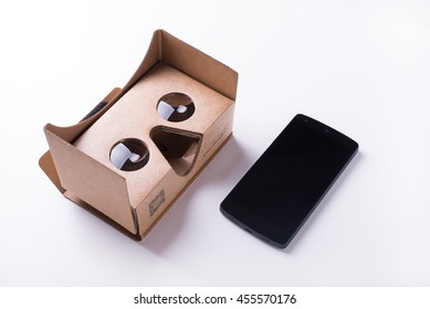 editorial shot of Google cardboard virtual reality headset and a smartphone. isolated over a white background. Taken on July, 2016.