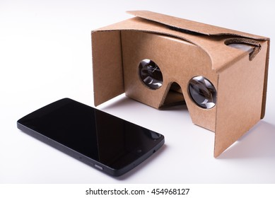 editorial shot for virtual reality headset and a smartphone by Google, assembled from pre-cut cardboard and bi-convex lenses. isolated over a white background. Taken on July, 2016.