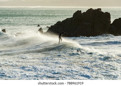 Editorial: Surfers in the sea during Storm Eleanor, St Ives, Cornwall, UK, 01/03/2018