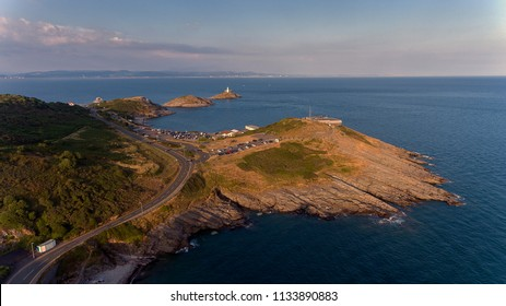 Editorial Swansea, UK - July 13, 2018: The landmarks of Mumbles, the Lighthouse, Bracelet Bay, Limeslade Bay and Tut Hill coastguard station on the Gower peninsula in Swansea, South Wales, UK.