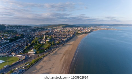 Editorial SWANSEA, UK - June 2, 2018: An aerial view of Swansea Bay, South Wales, UK, showing Victoria Park to the city centre