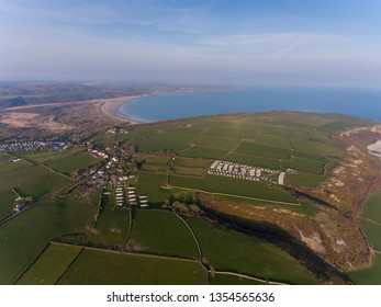 Editorial Swansea, UK - March 31, 2019: Aerial view of the Gower peninsula over Oxwich Green, Slade village, Oxwich castle and Oxwich Bay, Swansea UK