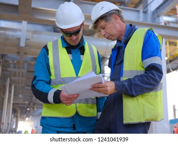 Editorial. Tobolsk; Russia; July; 28; 2018: Engineers are discussing a technological construction project. Construction scheme