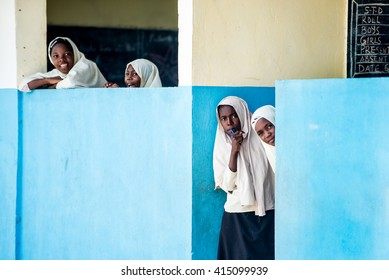 Editorial Use: Girls at school in Zanzibar, Tanzania, 04.2016. Children face tremendously poor life conditions in Africa but the interest in education is high. They are curious, witty and smart.