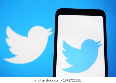 Editorial use, illustrative. In this photo illustration Twitter logo is displayed on a mobile phone and a monitor screen. Kyiv, Ukraine, January 11, 2021.