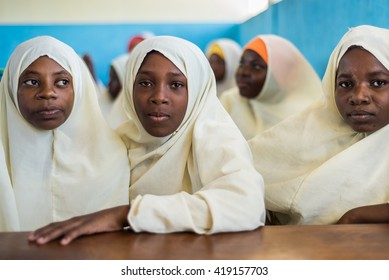 Editorial Use: Muslim girls at school in Zanzibar, Tanzania, 04.2016. Children face poor life conditions in rural Africa but the interest in education is high. They are curious, witty and smart.