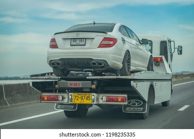 Editorial use only; a car being transported on a recovery truck, taken outside Bangkok, Thailand, in September 2018.
