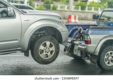 Editorial use only; a car  being towed on road, taken at Pathumthani, Thailand, in March 2019.