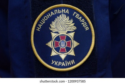Editorial use only. Chevron of National Guard of Ukraine on a sleeve of a coat. October 7, 2018. Kiev, Ukraine