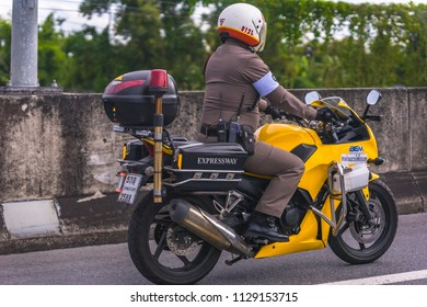 Editorial use only; an expressway policeman on a motorcycle, taken at Pathumthani, Thailand, on July 7th, 2018.