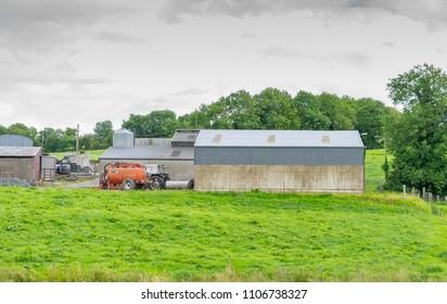 Editorial use only; farm houses and slurry tank spreader, taken at Cavan, Co. Cavan, Ireland, in July, 2017.
