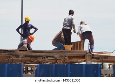 Editorial use only: A group of workers on the stands of the under-construction bungalow, taken at Kuala Lumpur, Malaysia, in June 26, 2019.