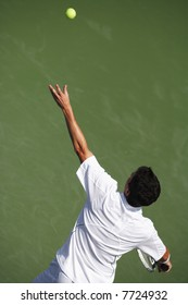EDITORIAL USE ONLY.  High angle view of tennis player serving.