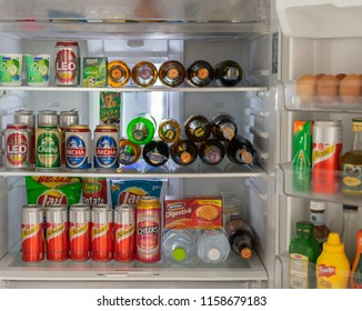 Editorial use only; a household fridge full of beer, soft drinks, and other items, taken at Pathumthani, Thailand, on August 18th, 2018.