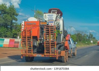 Editorial use only; a Kubota rice harvester machine being transported on a truck, taken at Sakon Nakhon, Thailand, in October 2018.
