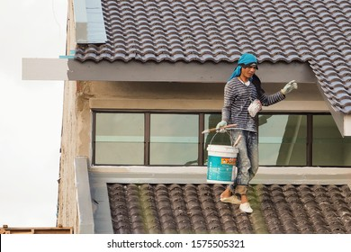Editorial use only; Laborer busy painting fascia cladding boards painting fascia cladding boards understand property roof constructed building, taken at Putrajaya, Malaysia, in December 1st, 2019.