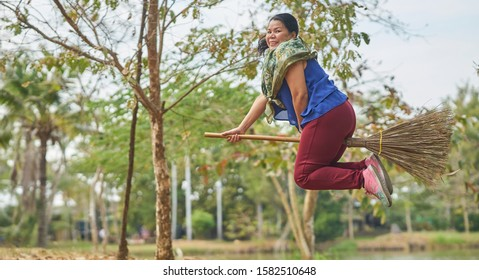 Editorial use only; a lady in flight on a broomstick, taken at Pathumthani, Thailand, in December 2019.