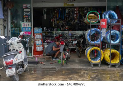 Editorial use only; a motorcycle repair shop, taken at Pathumthani, Thailand, in August 2019.