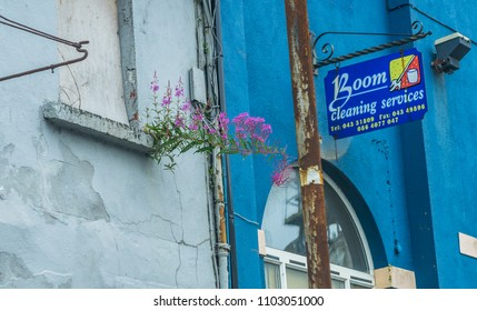 Editorial use only; a neglected building, with a sign, offering cleaning services, taken at Longford town, Co. Longford, Ireland, in July, 2017.