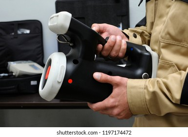 """Editorial use only. New radiation detectors testing. Dosimetrist holding a handheld radiation isotope identifier, black boxes on a background. October 1, 2018. State corporation """"Radon"""". Kiev,Ukraine"""