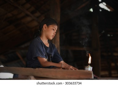 Editorial use only -   northeast Thailand- April 4, 2015- Young girl in home look for lamp.
