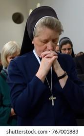 Editorial use only. Old nun praying in a church. Funeral of Liubomyr Huzar, the major archbishop of the Ukrainian Catholic Church. Ukraine, Kiev, May 5, 2017.
