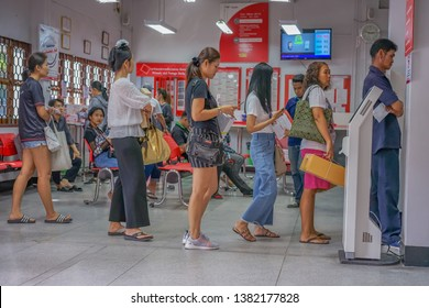 Editorial use only; people in a line at a post office, taken at Sriracha, Thailand, in September 2017.