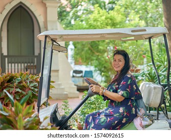 Editorial use only; a pretty lady driving a golf cart, taken at Ayutthaya, Thailand, in October 2019.