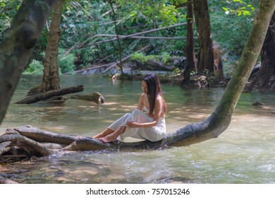 Editorial use only; pretty lady by a stream, at Kanchanabui, Thailand, taken on October 28th, 2017.