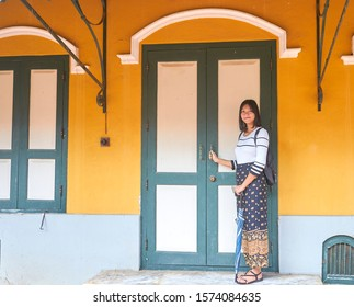 Editorial use only; a pretty Thai lady poses by an unusual temple that is designed in the same style as a christian cathedral, taken at Ayutthaya, Thailand, in October 2019.