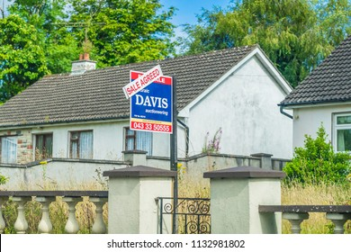 Editorial use only; real estate for sale sign and 'SOLD' sign in front of property, taken at Drumlish, Co. Longford, Ireland, in July 2017.