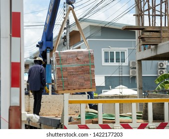 Editorial use only; red bricks being unloaded from a truck, taken at Pathumthani, Thailand, in June 2019.