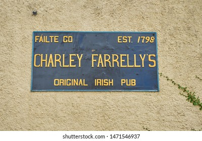 Editorial use only; a sign for an Irish pub, on a wall, taken in Carrigallen, Co. Leitrim, Ireland, in July 2017.