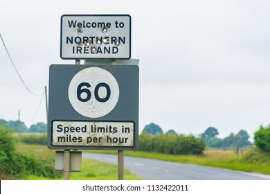 Editorial use only; a signpost and speed limit sign, the sign has the text  ' Welcome to Northern Ireland ', taken outside Ballyconnell, Co. Cavan, Ireland, in July 2017.