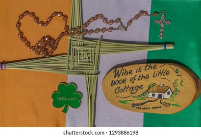 Editorial use only; a St. Brigid's Cross with shamrock, and prayer beads, on an Irish flag, taken at Pathumthani, Thailand, on January 24th, 2019.