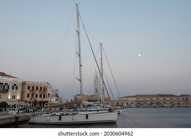 """""""Editorial use only"""" Syros port in Ermouplis with sailing boats and beautiful buildings in the sunrise. Ermoupolis, Syros, Greece - August - 24 - 2021.""""Editorial use only"""""""