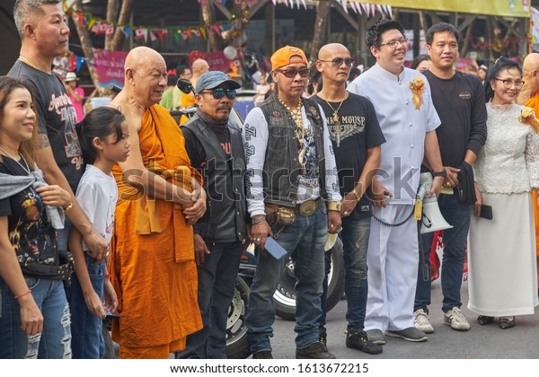 Editorial use only; Thai Buddhist monks and bikers pose for photos, at a temple, taken in Pathumthani, Thailand, on Children's Day in January 2020.